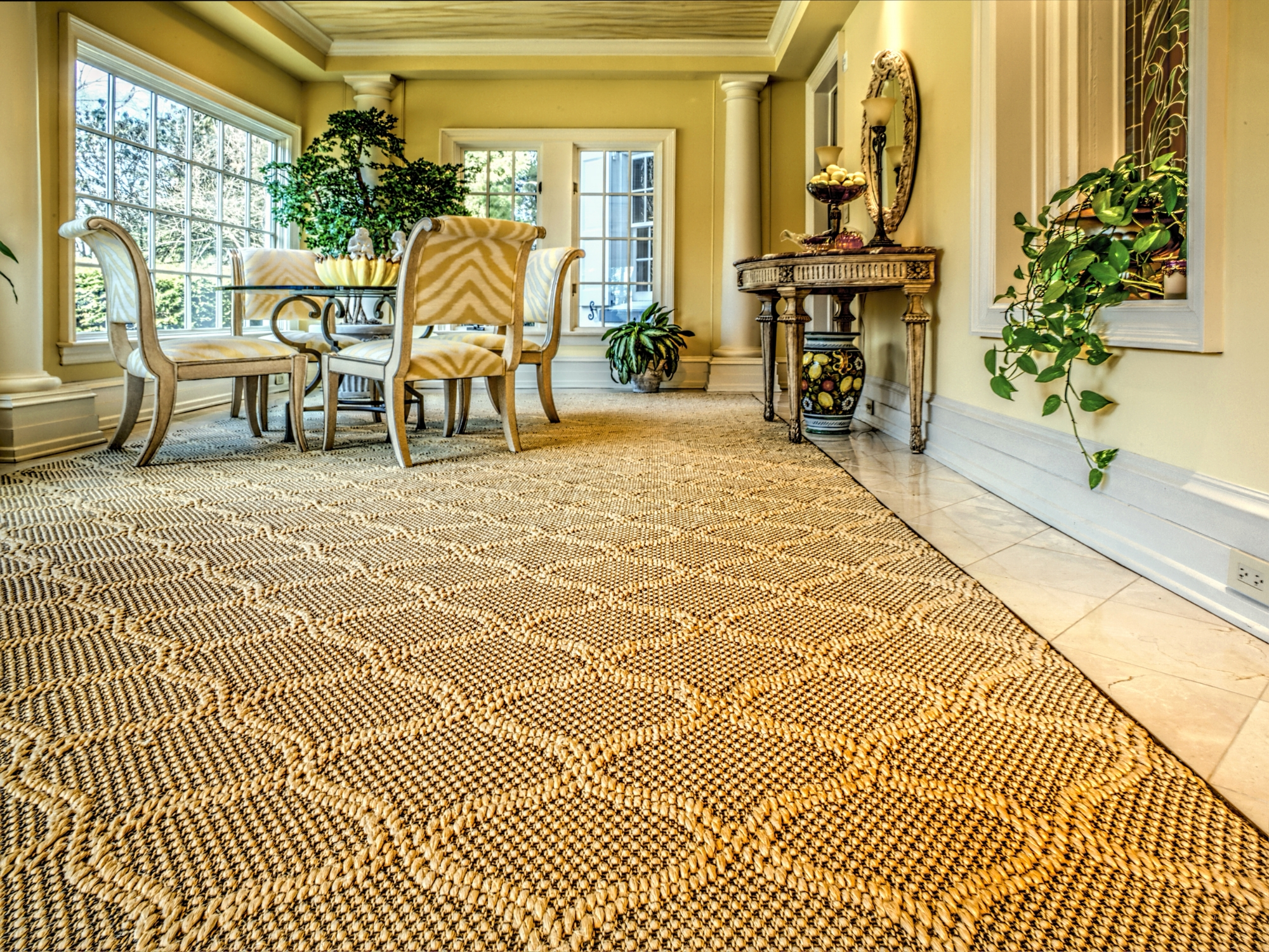 This is an elegant, gold sisal area rug that we made custom-made for our customer in our on-site carpet workroom.