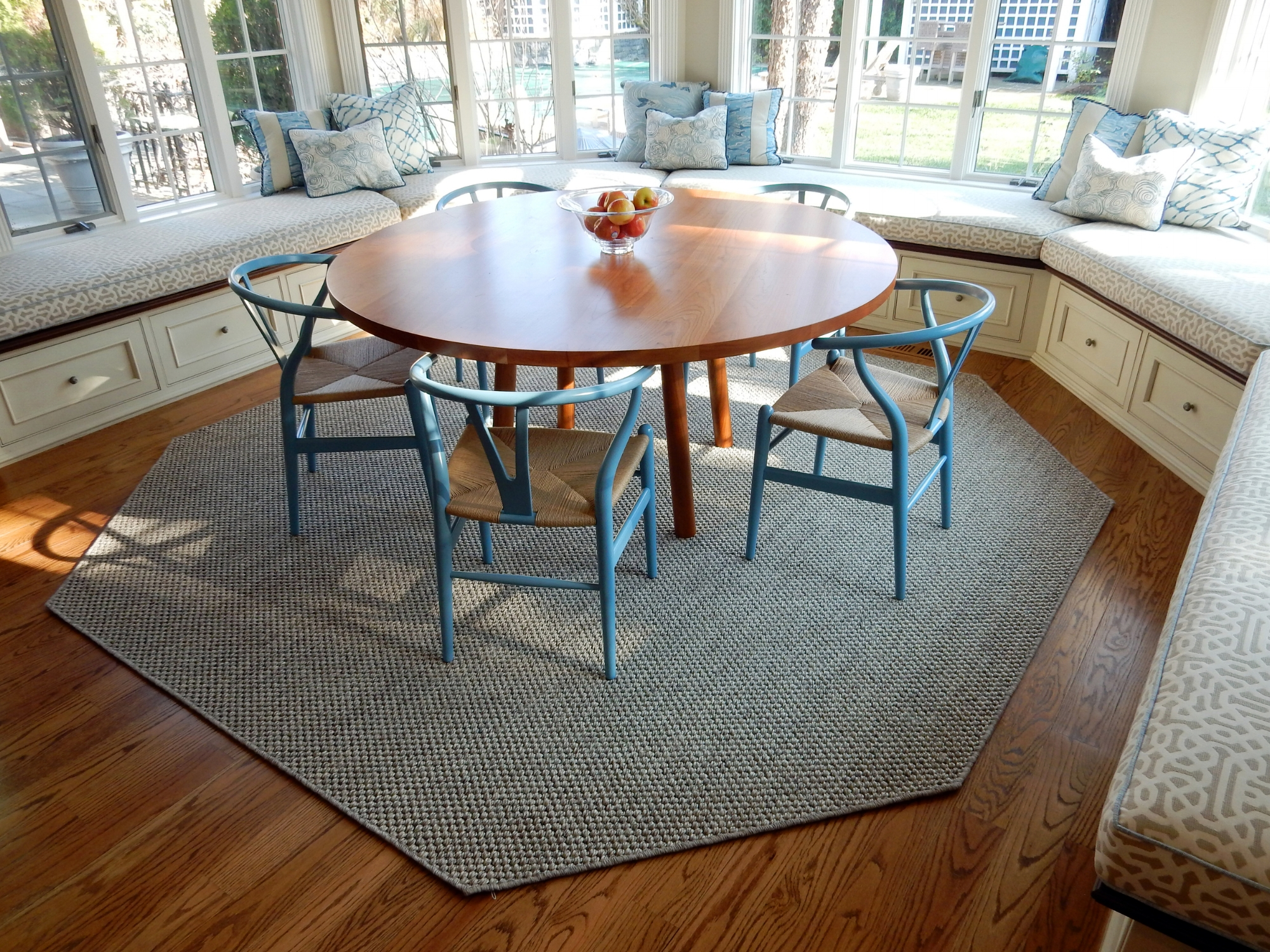 Custom-made octagonal sisal rug under a dining table in a breakfast nook