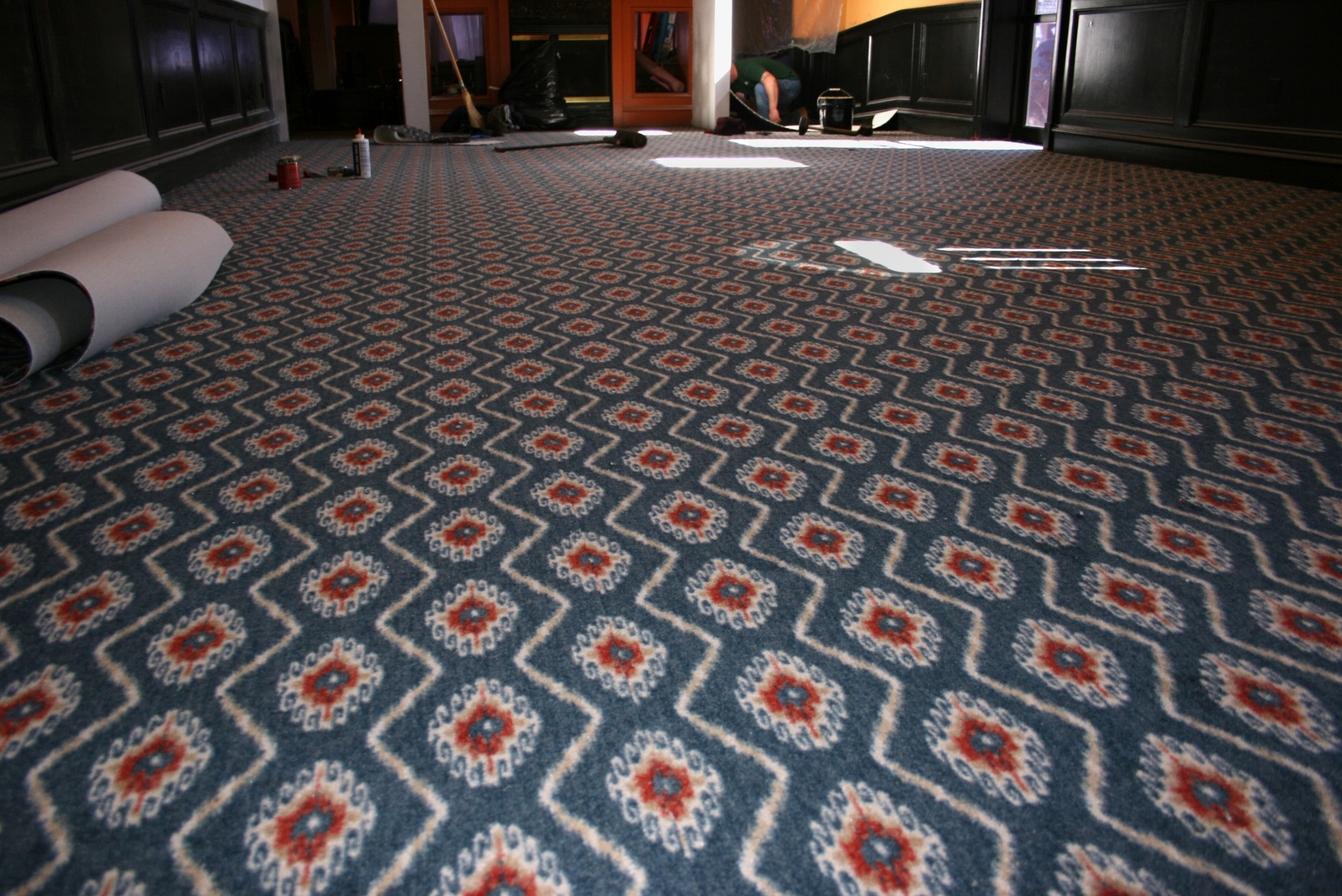 Vibrant patterned carpeting in the local 8th & Union Kitchen restaurant