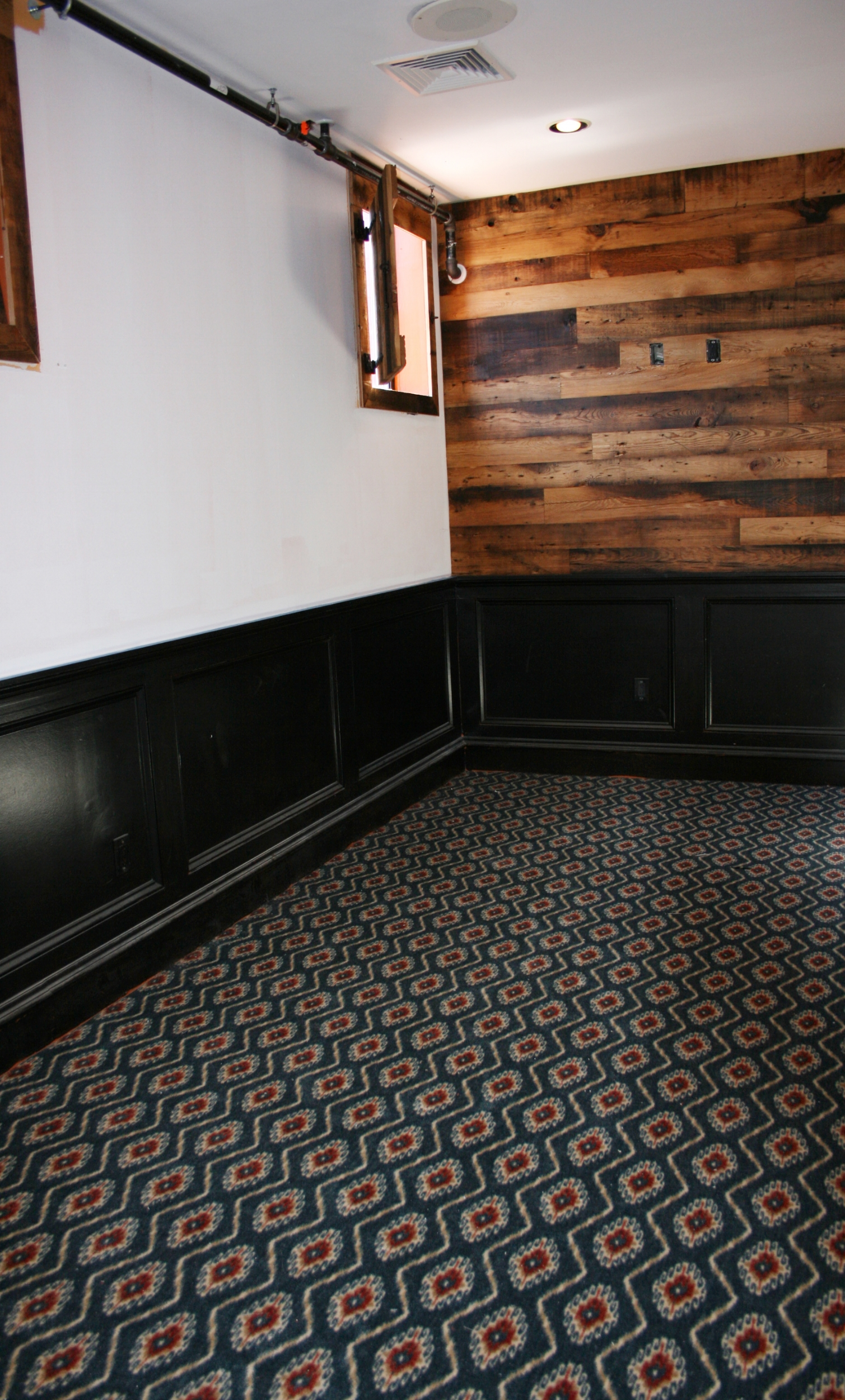 Bold patterned carpeting installed in a restaurant event space