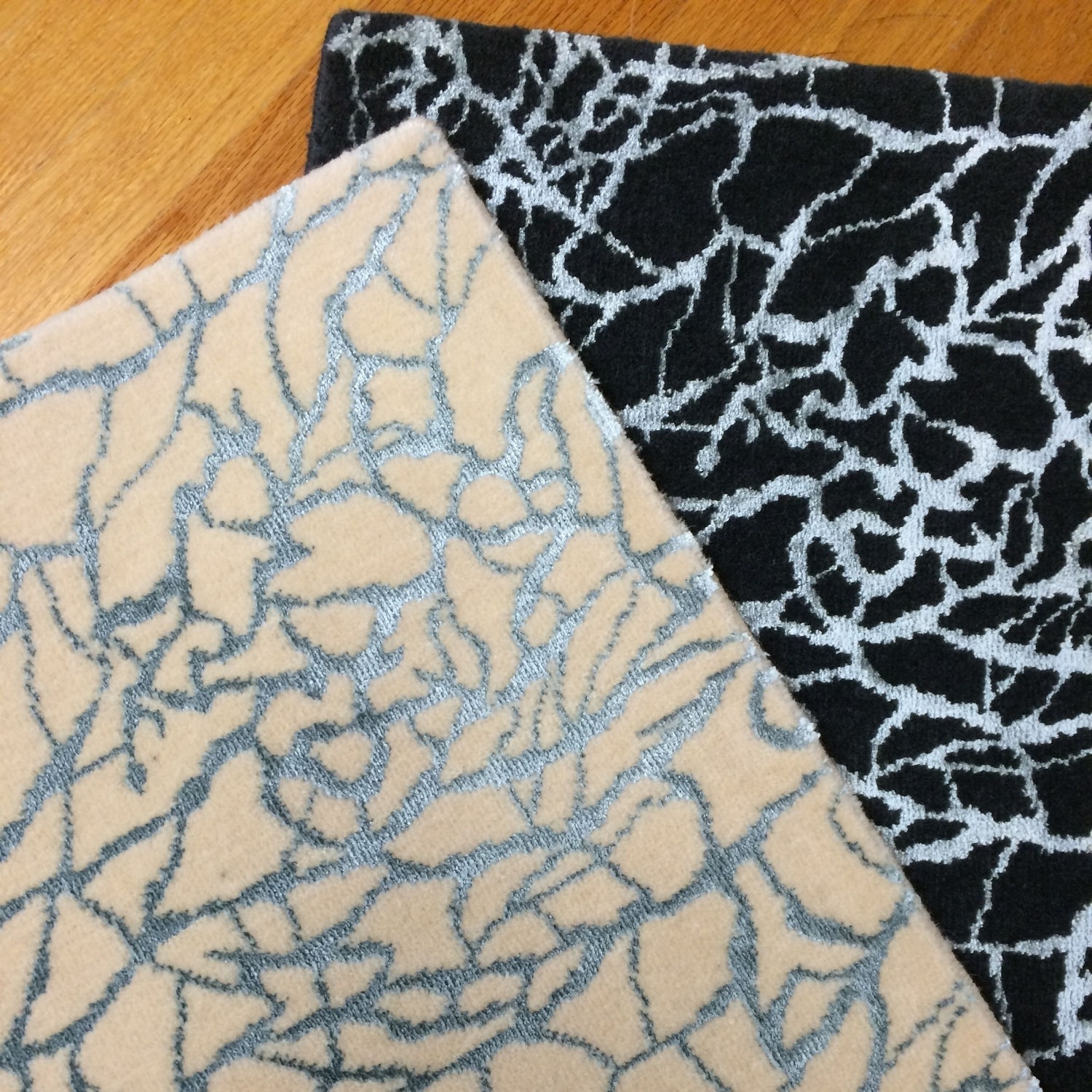 Wool carpet samples with teal shine accent in ivory and black