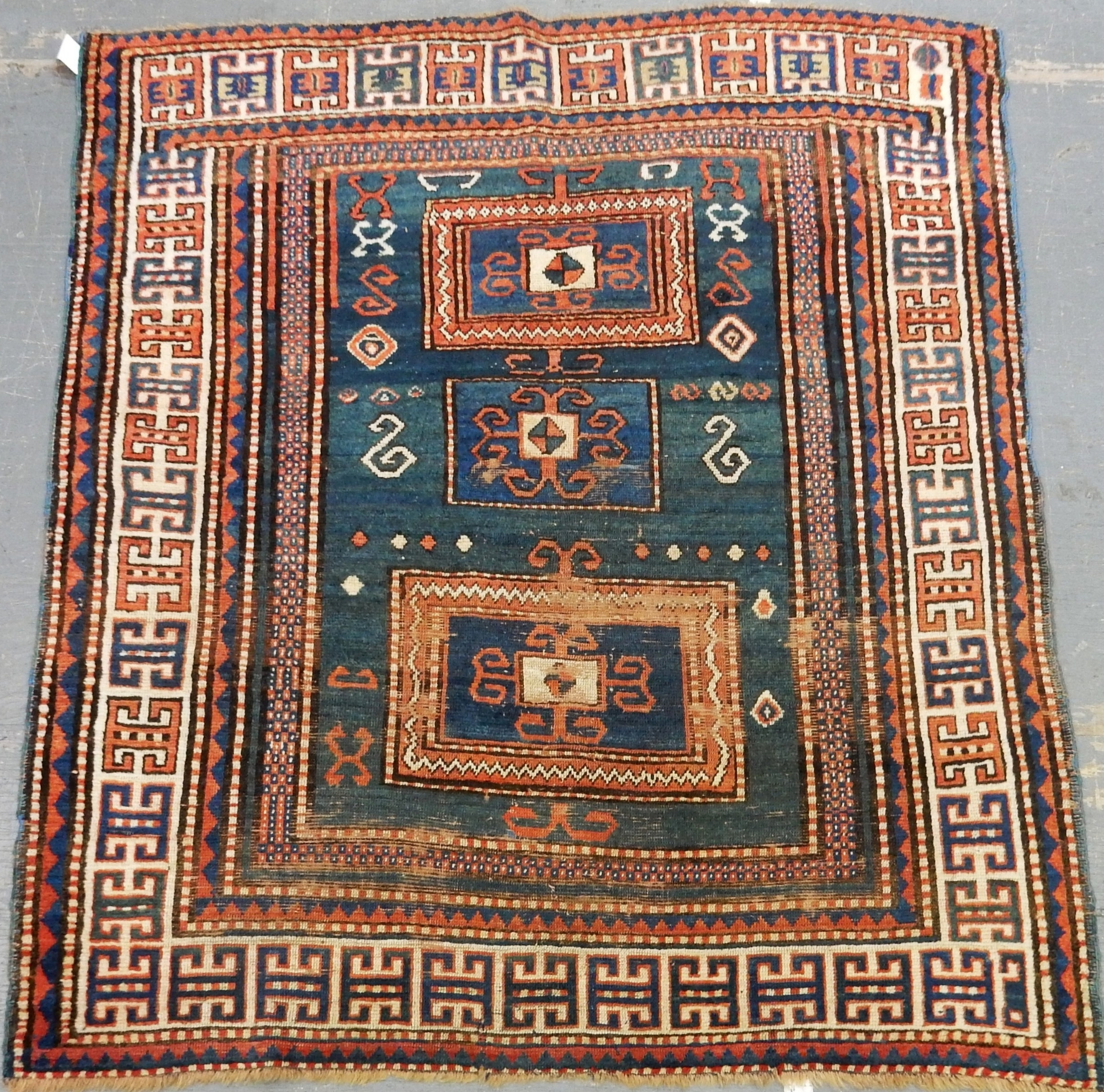 Antique rust, navy, and ivory hand-knotted oriental rug