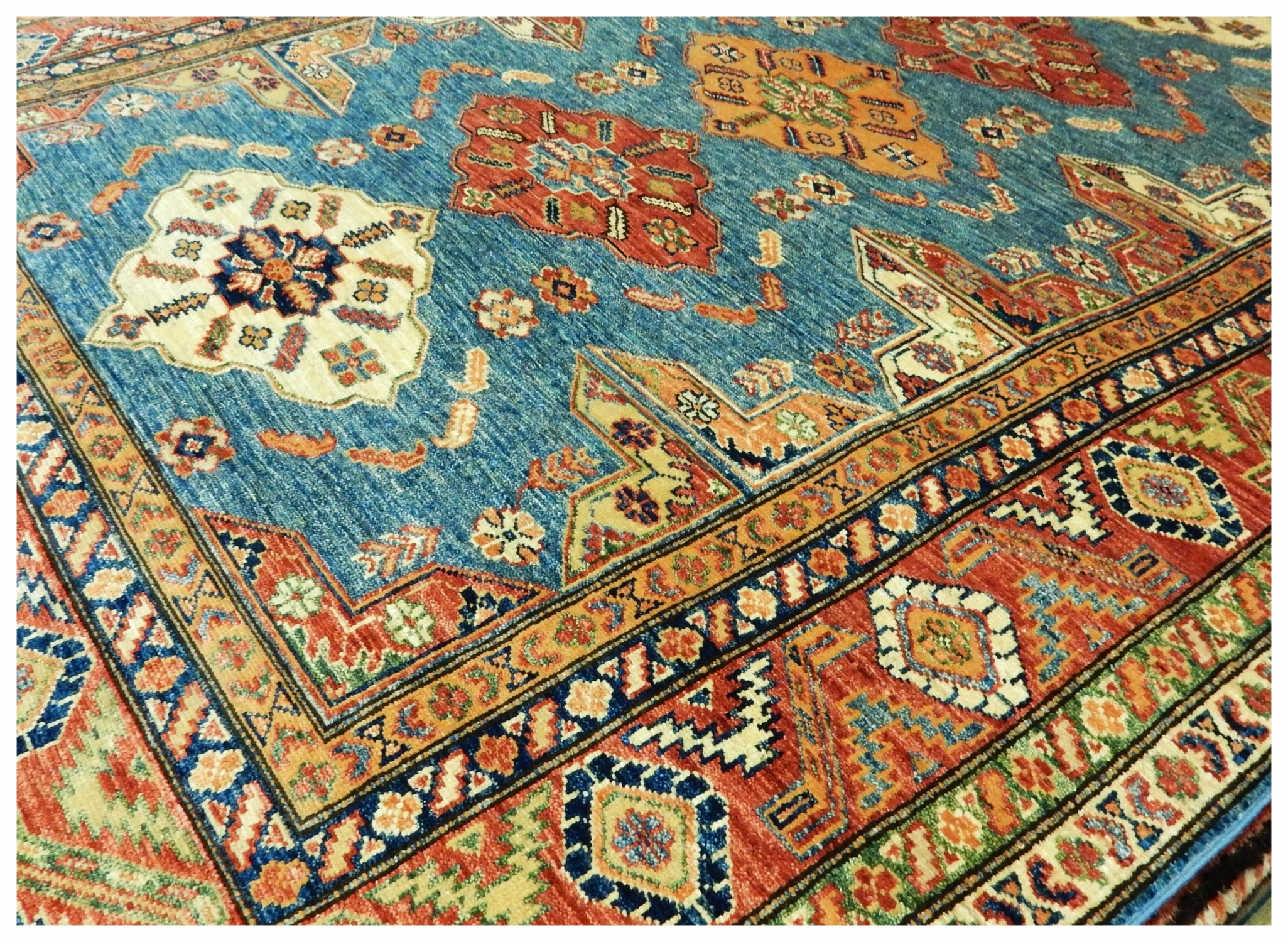 Teal, Gold, and Red Oriental Rug