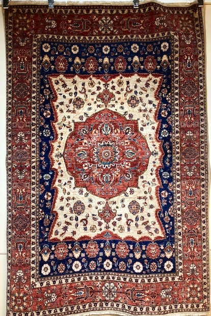 Blue and rust center medallion Persian rug.