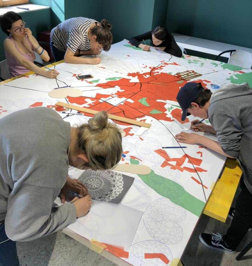 Interns at work in the Pristina studio - designing the painting