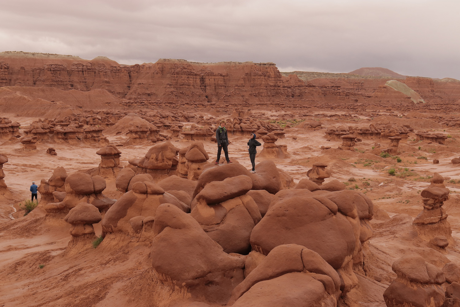 Addy and Andrew having fun on a drizzly, location scouting day at Goblin Valley.