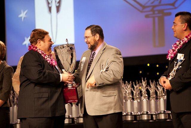 Matt Davis (middle) accepts Pi Kappa Delta Bruno E. Jacob Trophy at National Speech & Debate Association Tournament
