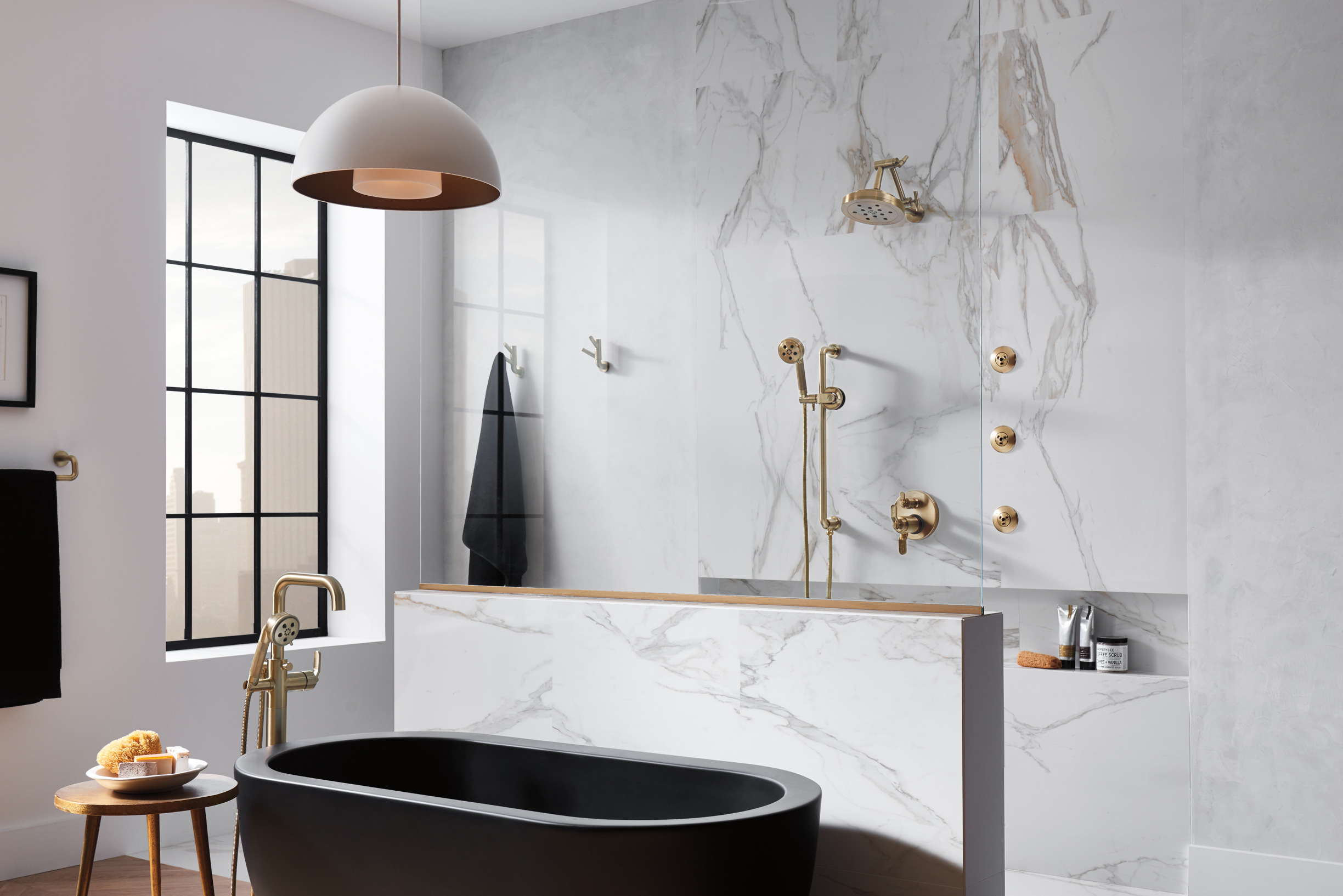 Brizo Litze collection minimal bathroom   showroom interior with marble shower and brass fixtures