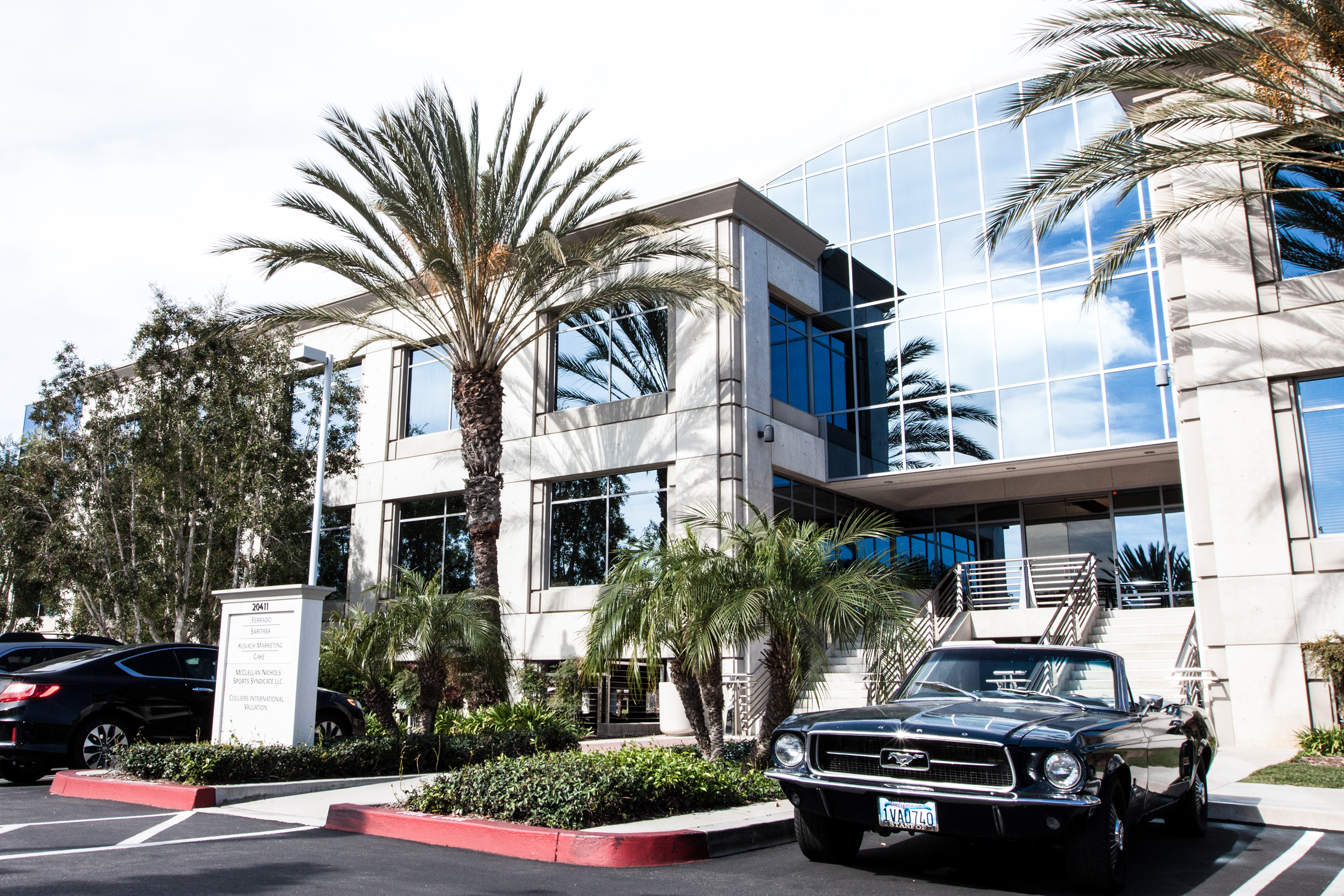 Newport Office parking exterior landscaping with Mustang car