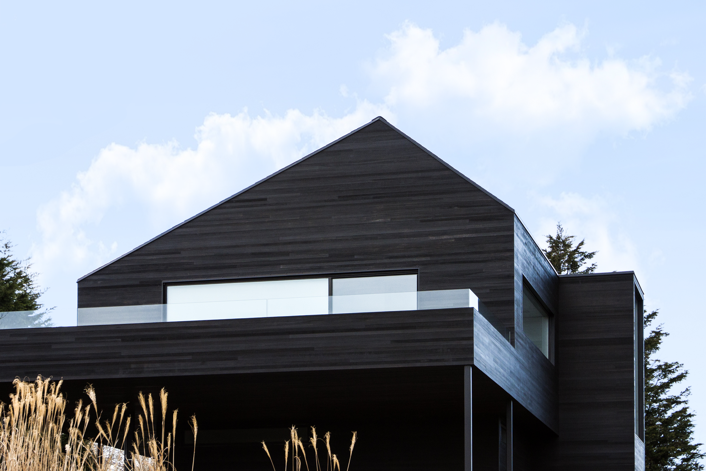 Black Modern barn house with Shou Sugi Ban cedar siding
