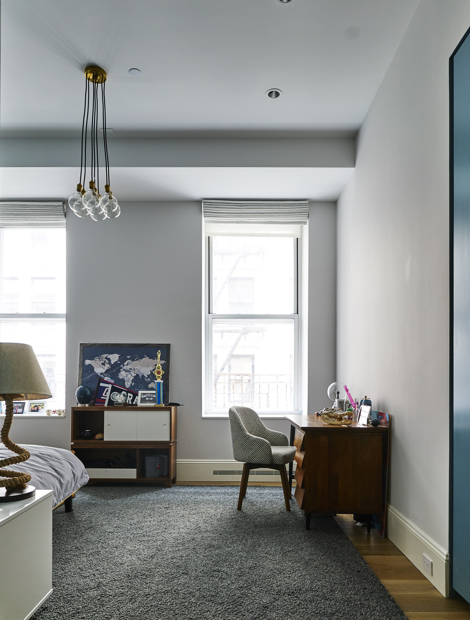 Modern Soho loft renovation young blue boy's room