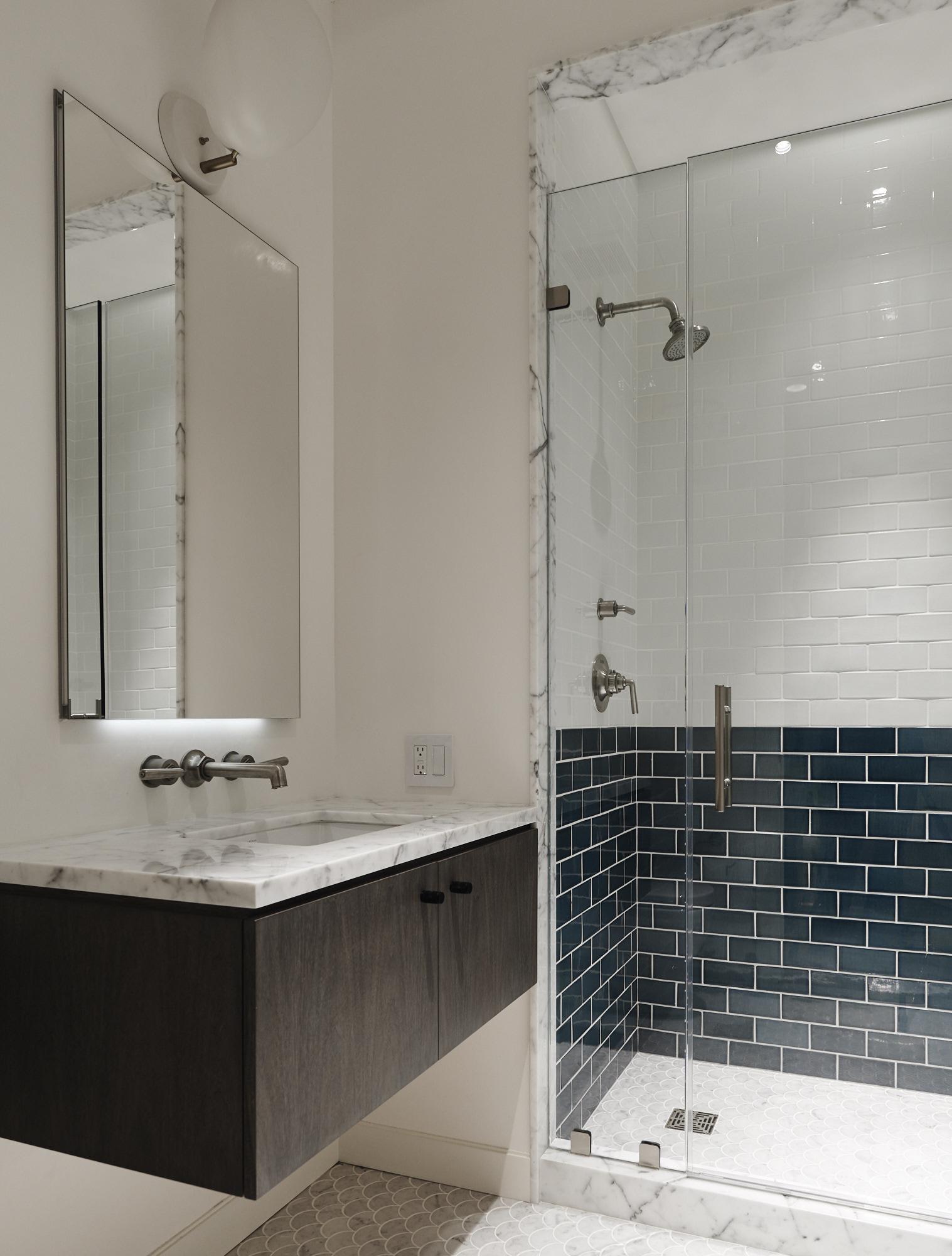 Modern Soho loft bathroom renovation minimal white and blue tile