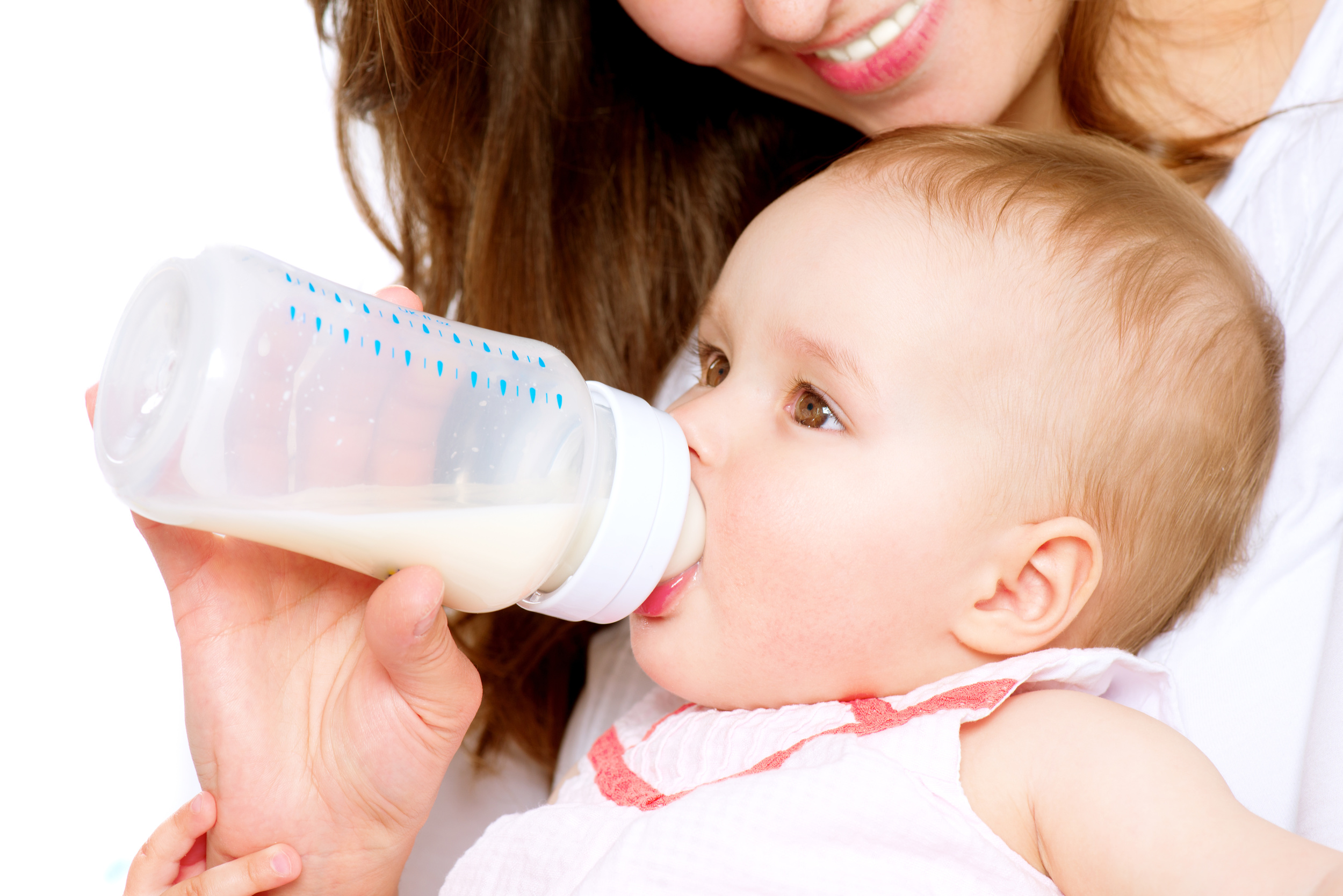 Baby being fed infant formula by mother