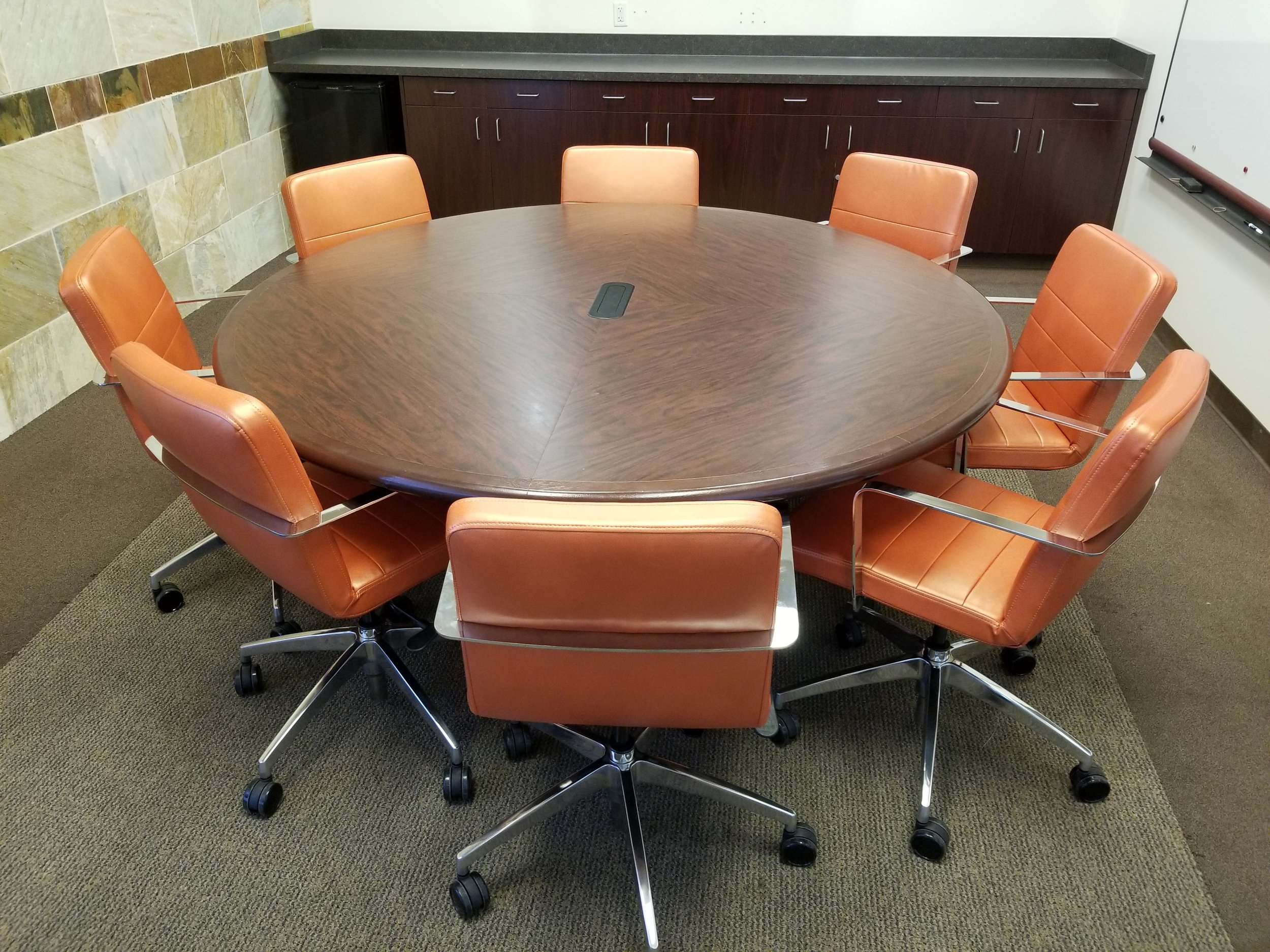 "Consolidated Office Systems    The Diddy Series was the perfect solution for a 60"" round conference table. With the small footprint the Diddy has the ability to fit in many different environments. Plus the mid-century modern wrap around chrome arm helps bring back the 1960's Mad Men days."