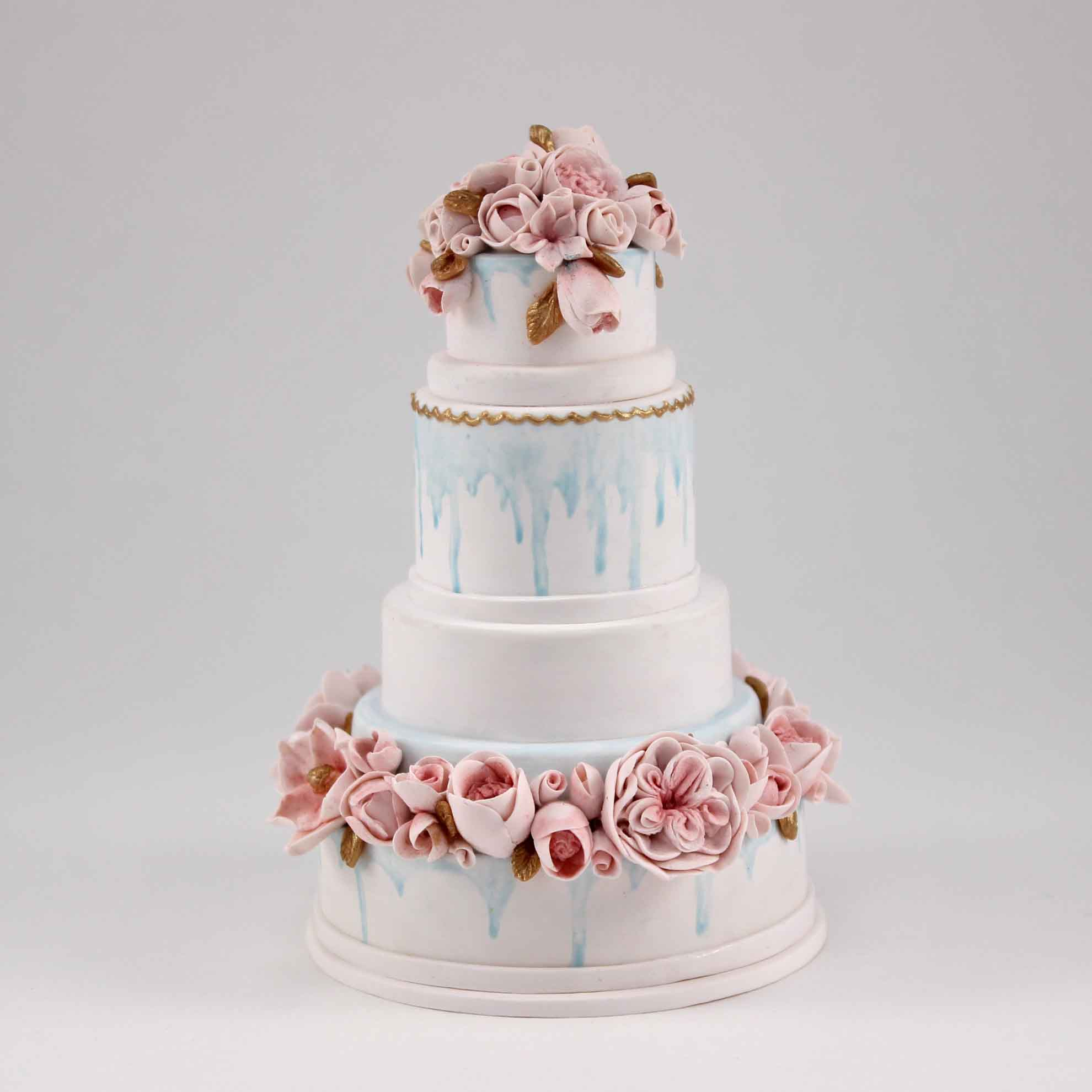 Minature of beautiful wedding cake with sugarflowers and light blue painted.jpg
