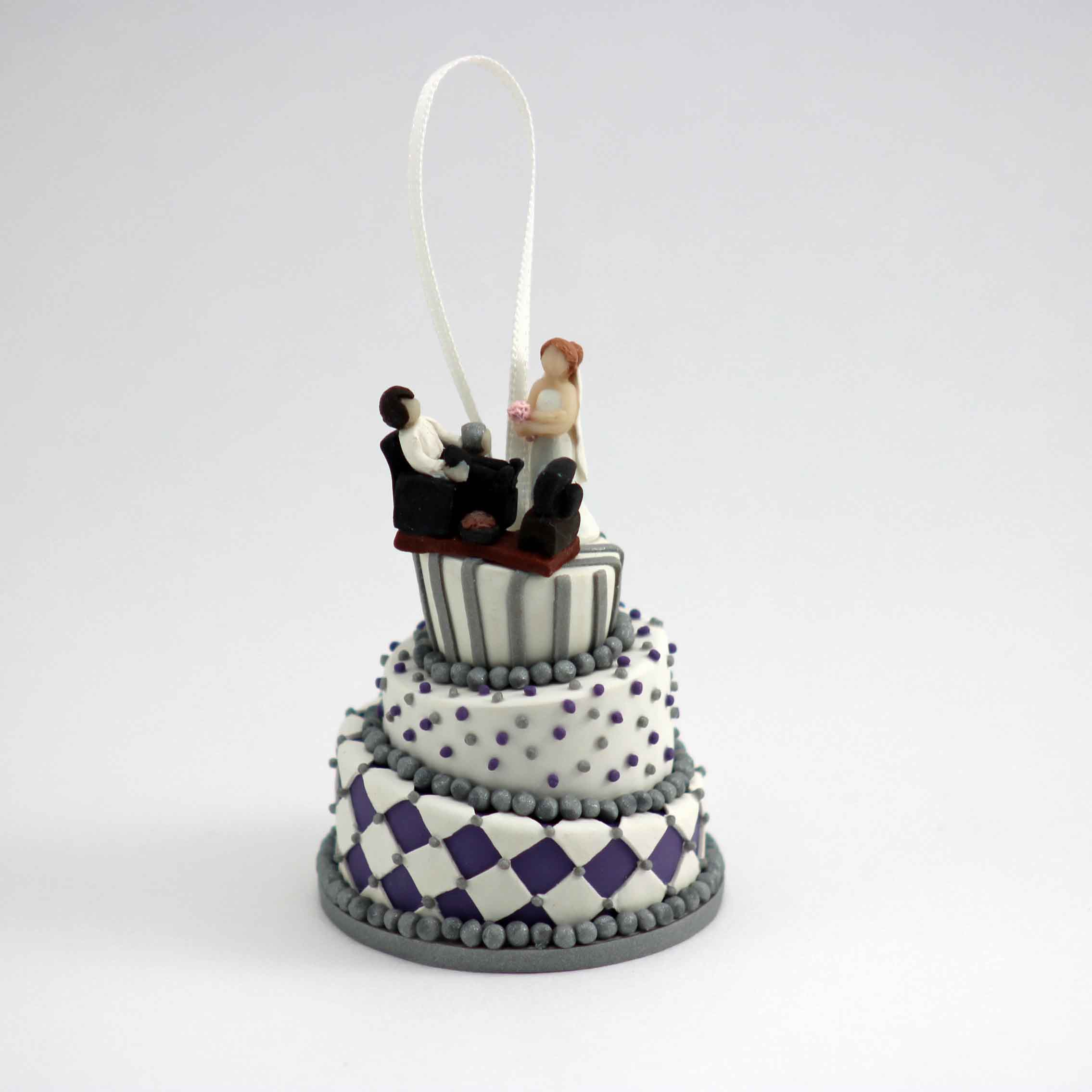 Minature of a wedding cake silver and purple with couple on top.jpg