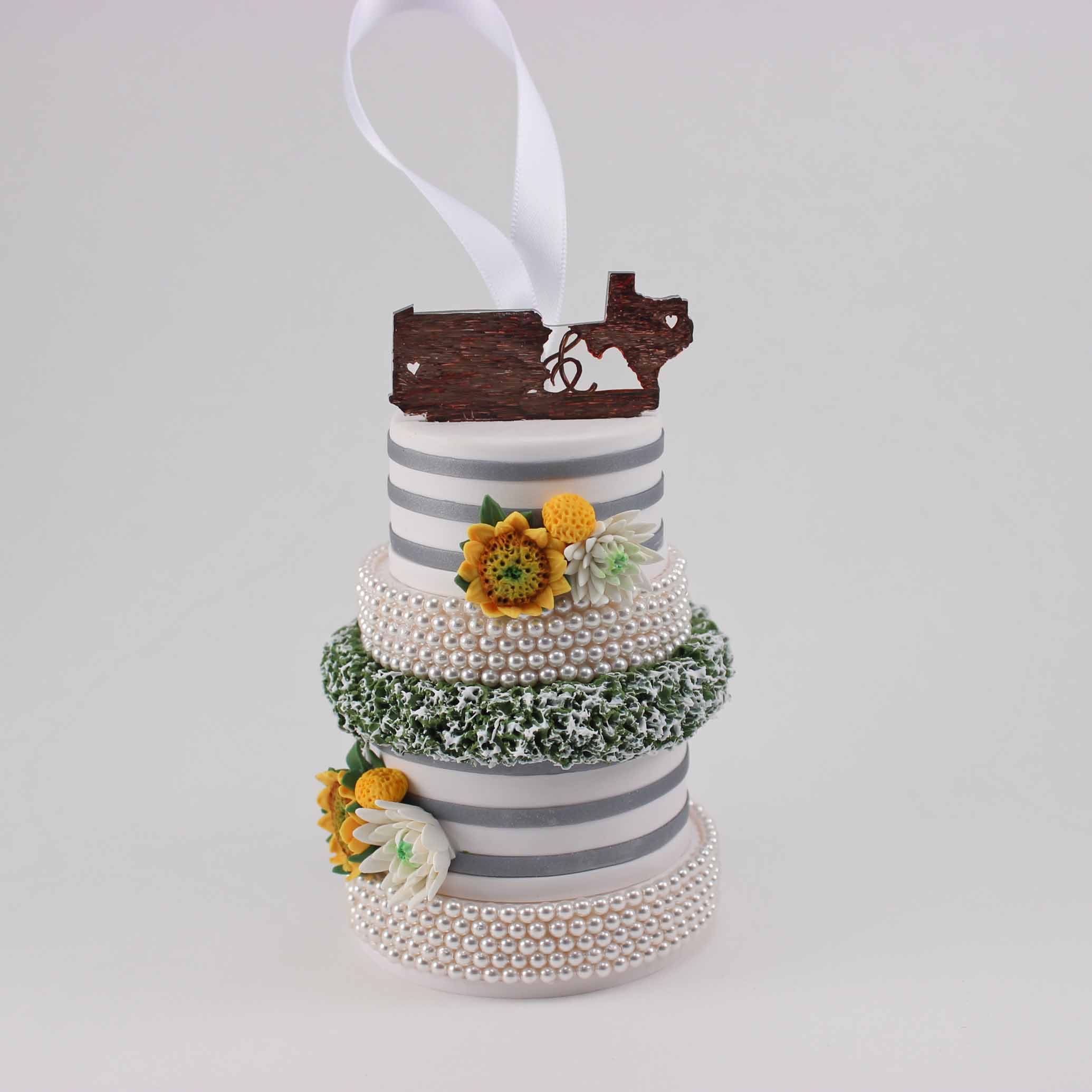 Mini replica of wedding cake with pa and TX cake topper.jpg