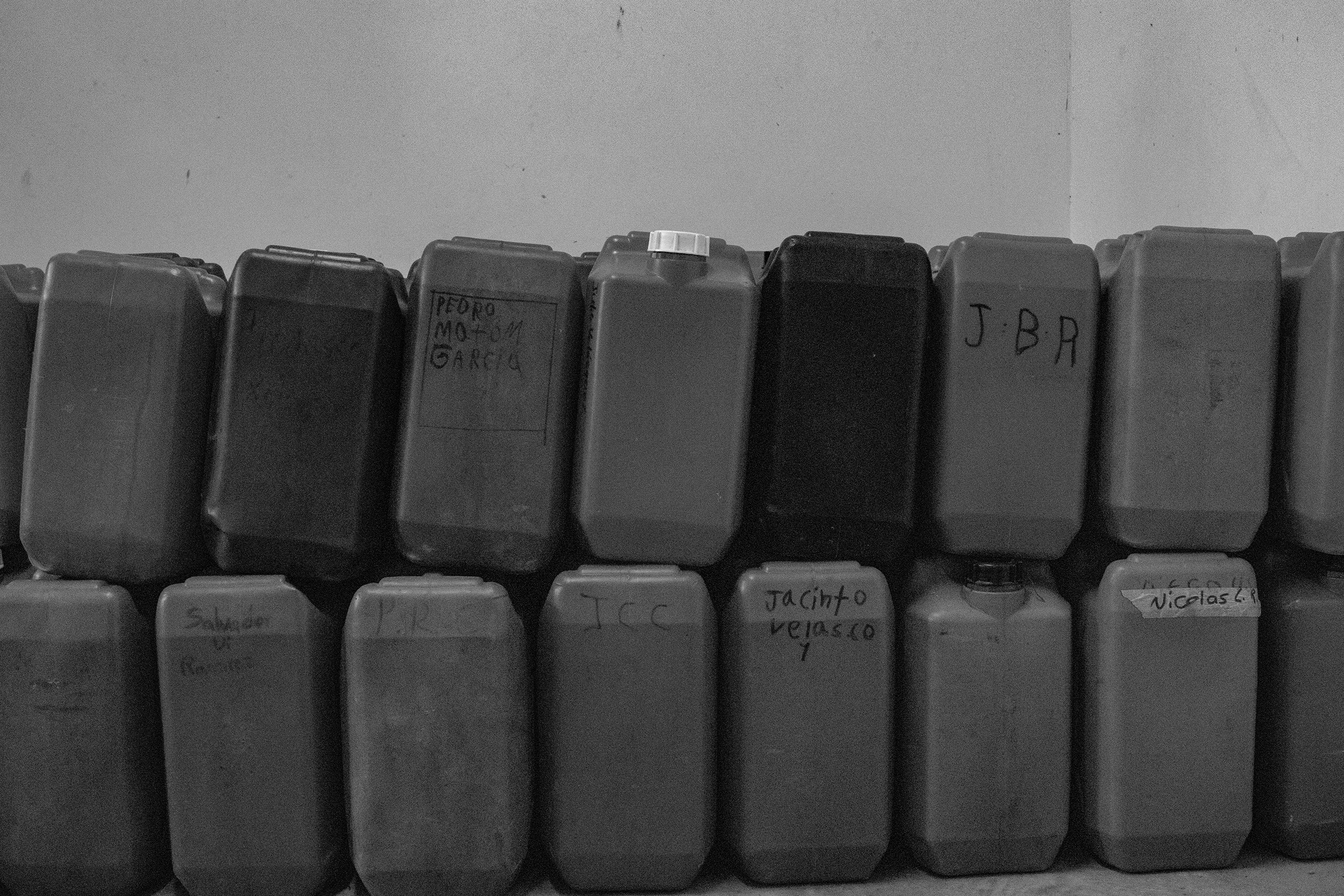Labeled jugs used to transport honey.