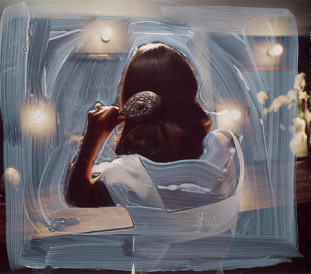 Woman Brushing Her Hair,  latex on magazine