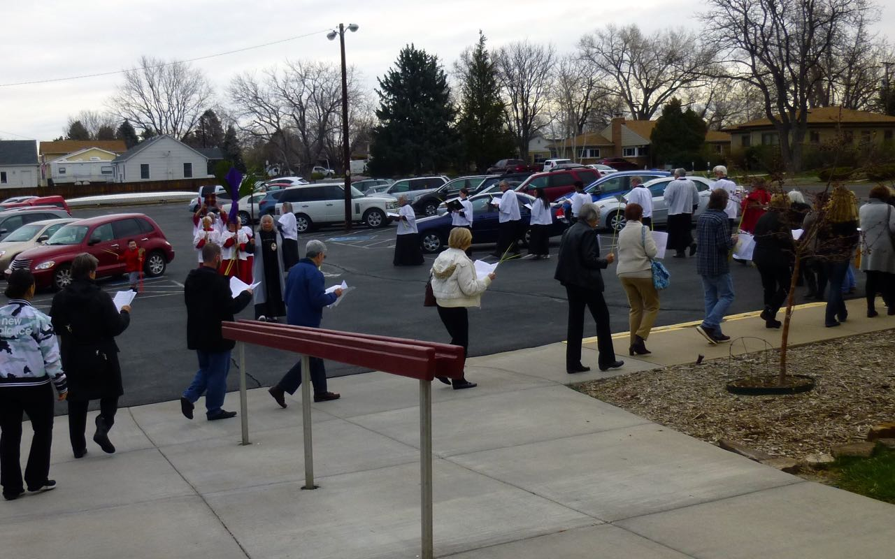 Palm procession through the parking lot.jpg