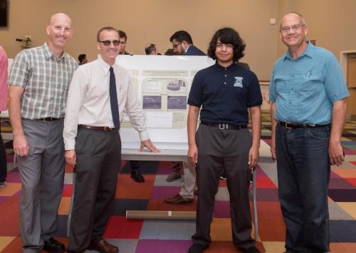 Jesus with his mentor, Dr. DellaCorte, and NASA scientists at NASA Glenn during his presentation.