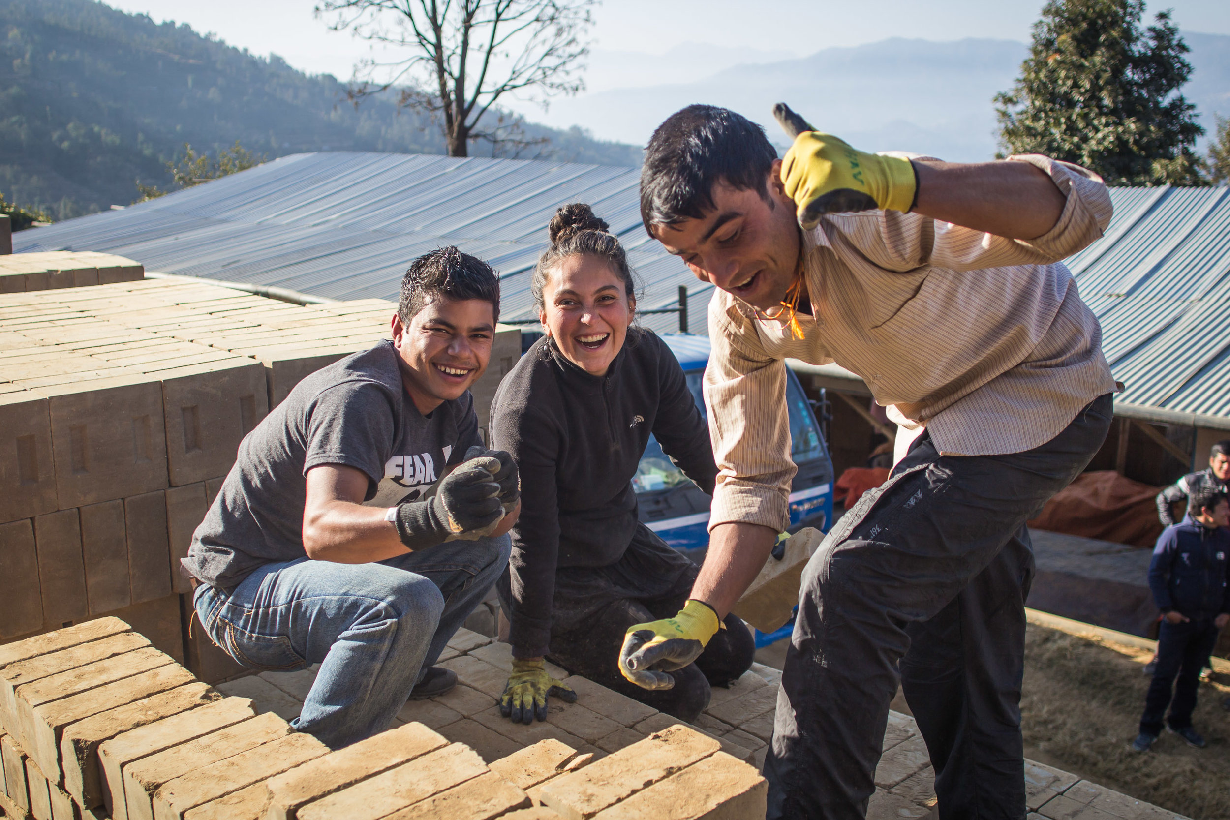 Our volunteer and Nepali team working together.jpg