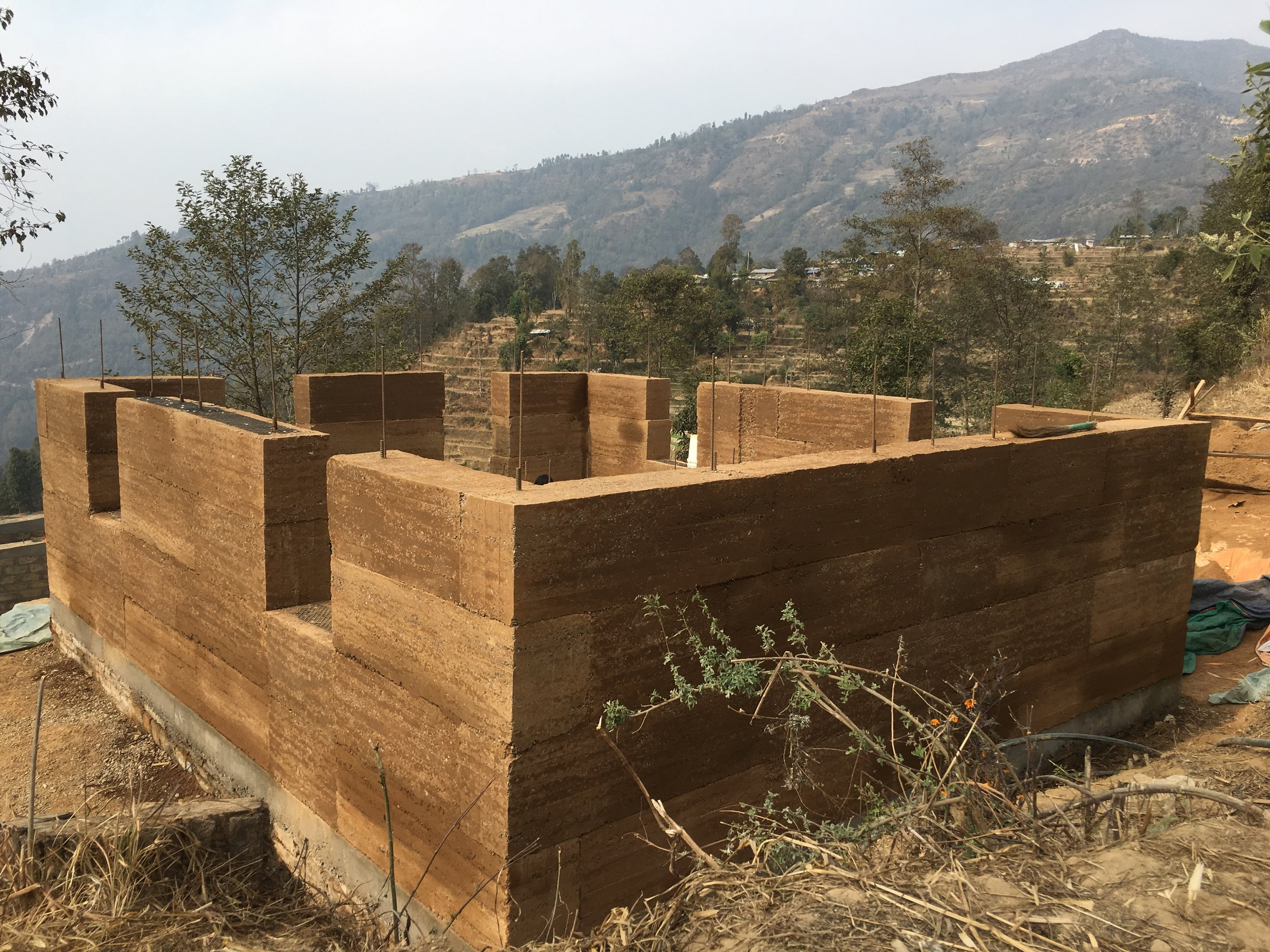 The completed ramed earth walls. Photo: Oliver James Atwood