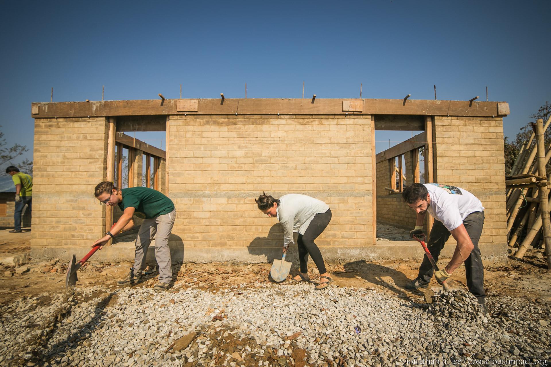 A spanish-speaking volunteer team digging the foundation for the vernanda.