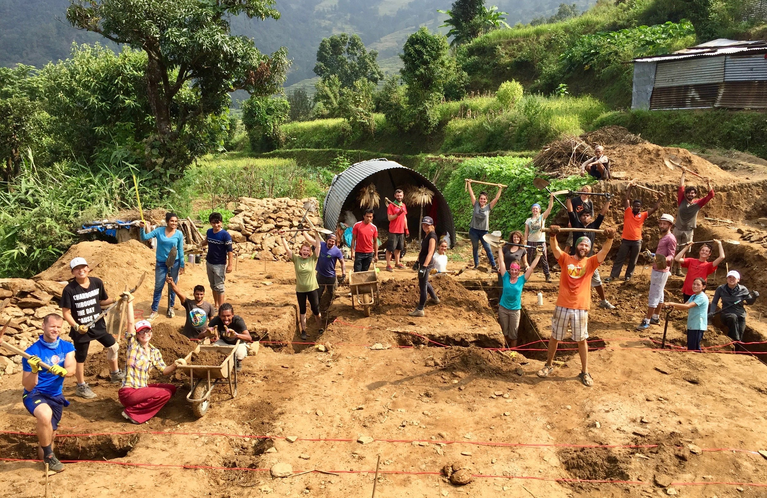 "Our amazing ""groundbreaking"" team of volunteers and Nepali staff working hard to dig the foundation of our newest project, the Bimire Earthbag House."