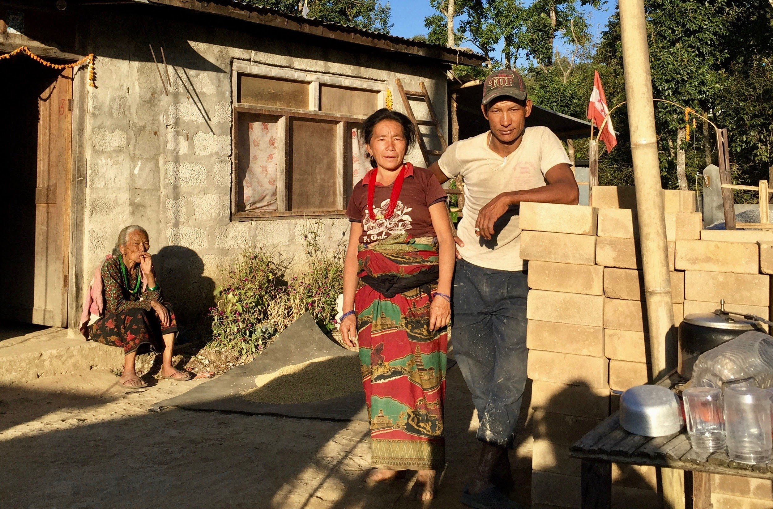Photo 5: The first brick purchase of Season 3! Prem Bahadur Tamang and his wife stand proudly next to their CSEBs. In the 2015 earthquake, their two-story stone structure fell. Now, they will use these bricks to build their new home, beautiful and earthquake safe. Our hope is that Conscious Impact can support at least 20 other families to have the same opportunity.