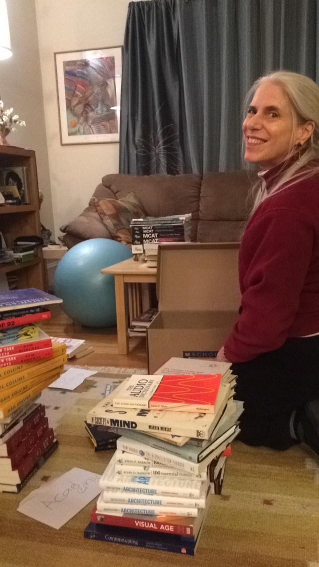 My Momma, helping to sort and organize books!