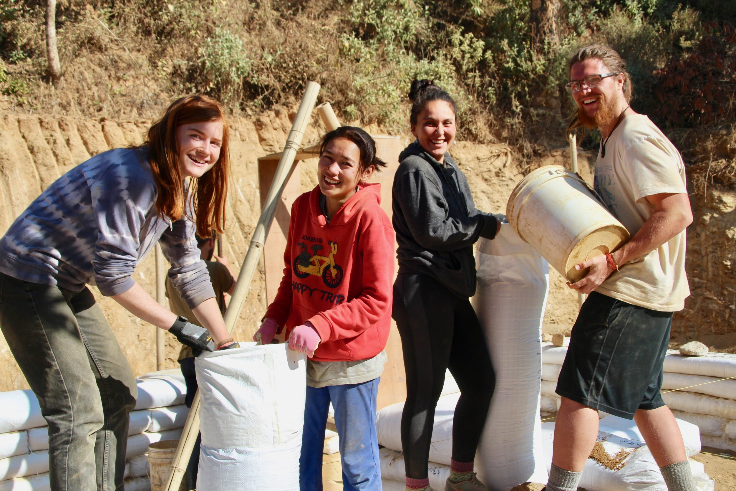 Conscious Impact volunteers filling earthbags during the construction of the new Takure Coffee Cooperative.