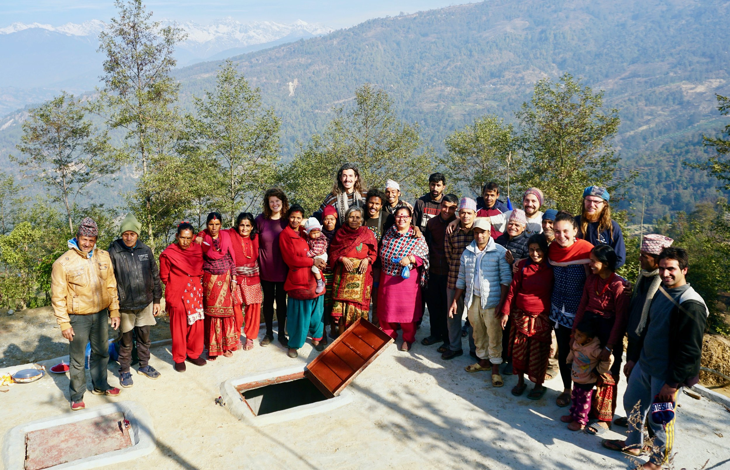 Community members and volunteers stand proudly on the new 40,000 liter water tank. Photo by Ankit Tanu