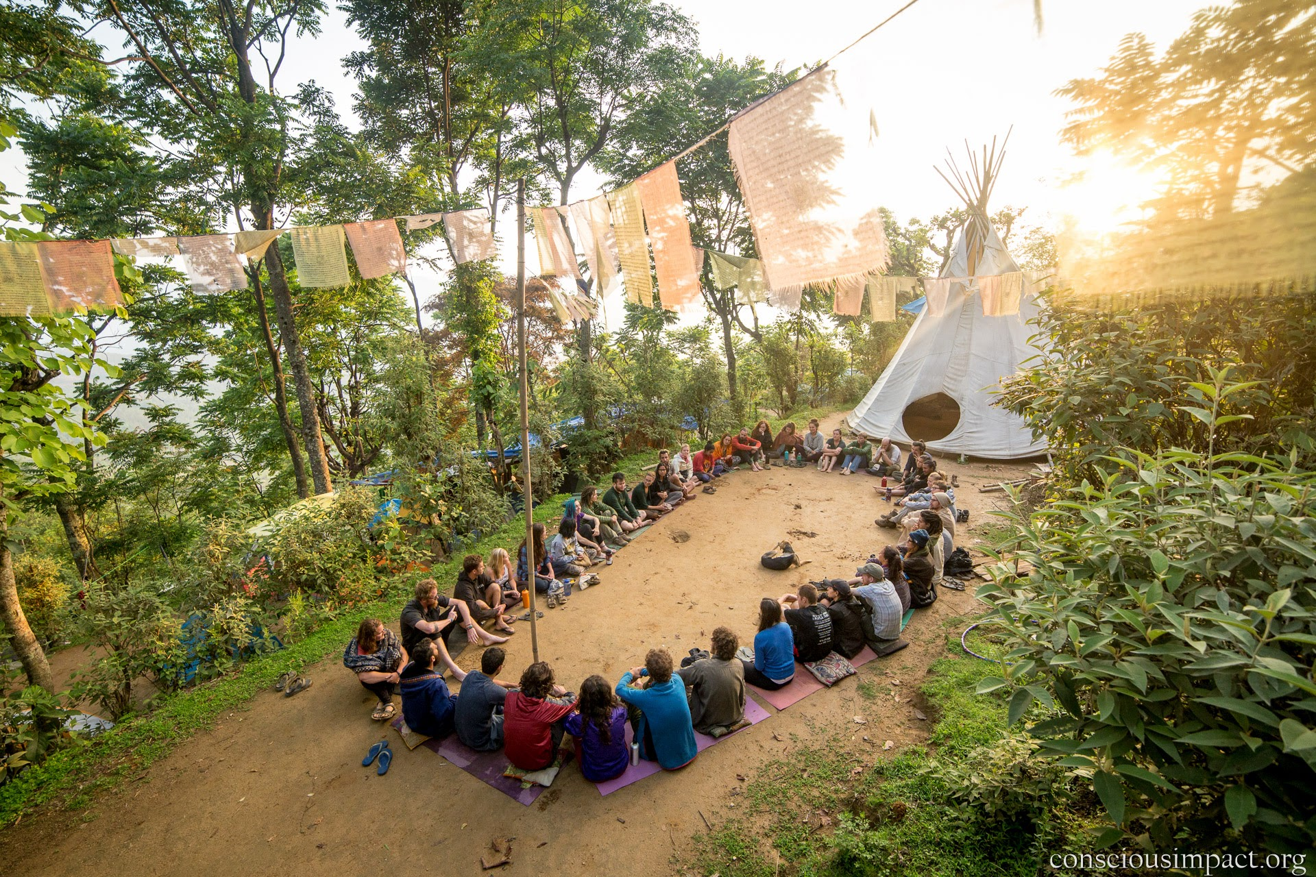 Conscious Impact volunteers gather to share gratitude at our camp in Takure. Photo by Jonathan H. Lee