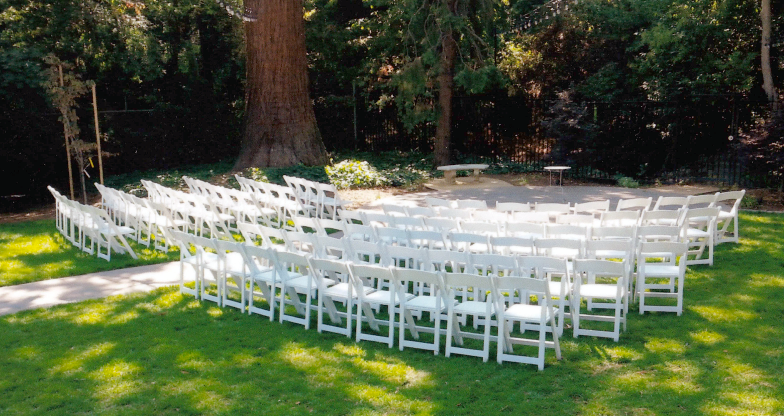 White wooden chairs and tables are available for rent (Silver Package excluded). These are included in the Diamond Package.
