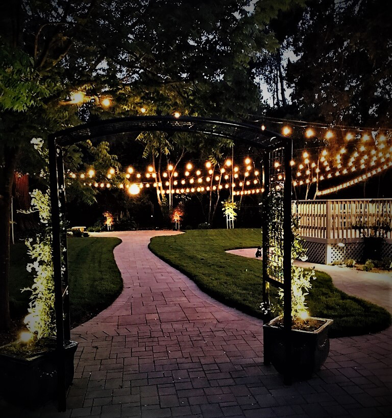 Lighting   The Old Homestead is equipped with an electrical infrastructure to support audio and video. We provide spot lighting, pathway lighting and banister lighting in the backyard. String lighting is included in the Diamond Package.
