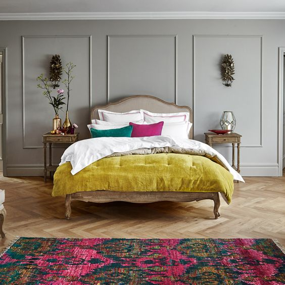 Grey bedroom with pops of colour