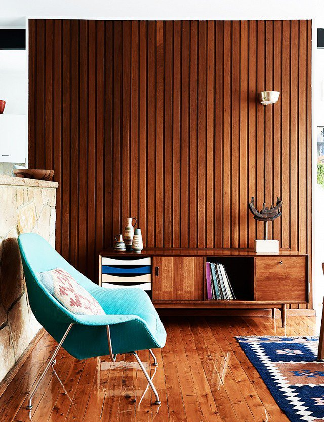 Wood clad walls and floors in this mid century modern interiors scheme.