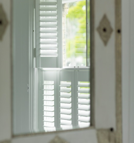 An alternative to curtains are shutters like these by Luxaflex.