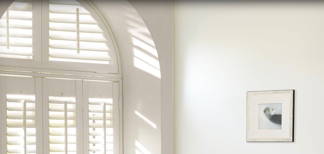 A lovely alternative to curtains are shutters by Luxaflex.