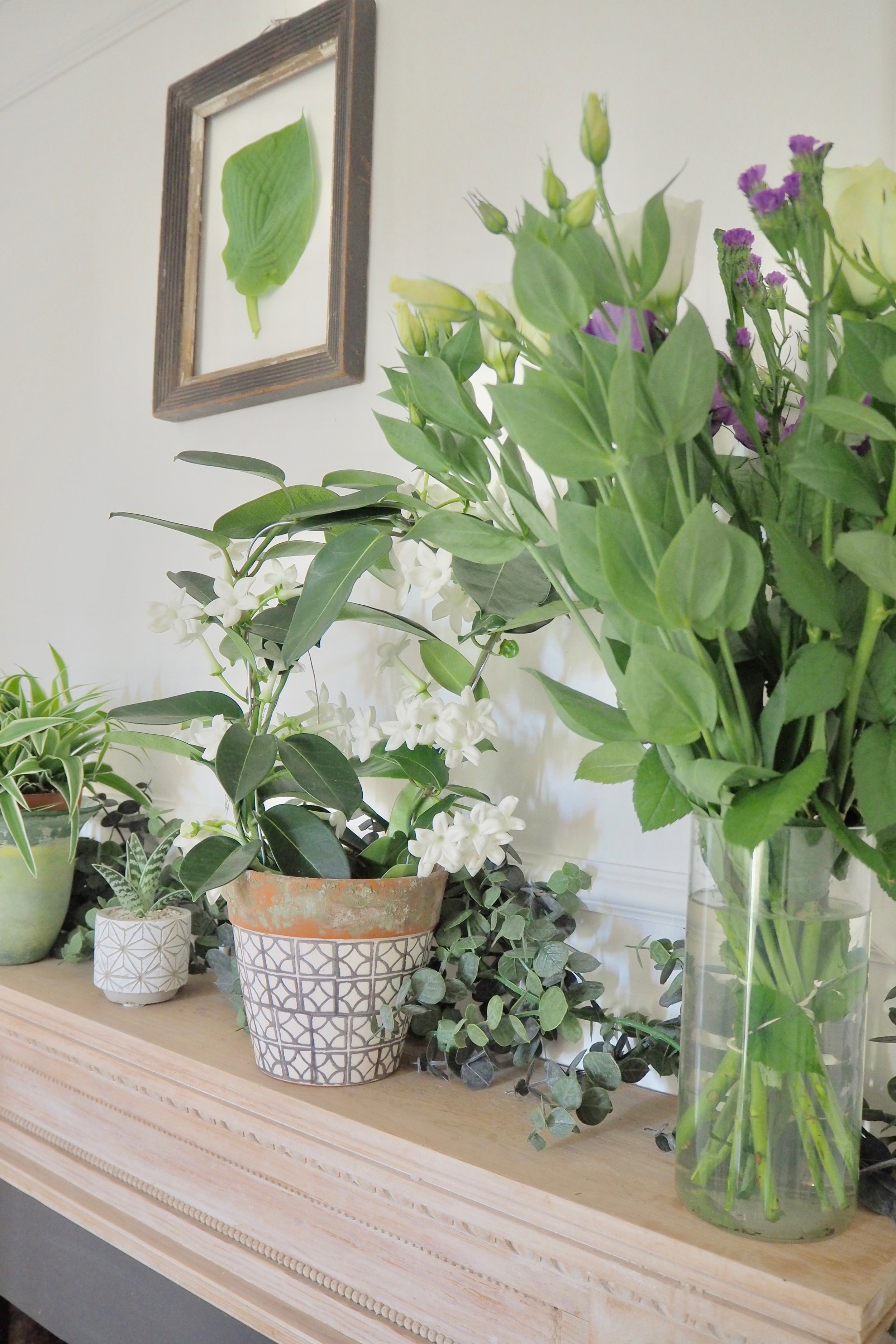 How to style your mantelpiece to create an interesting and different feature. Try using greenery like this example from Camilla Pearl Blog.
