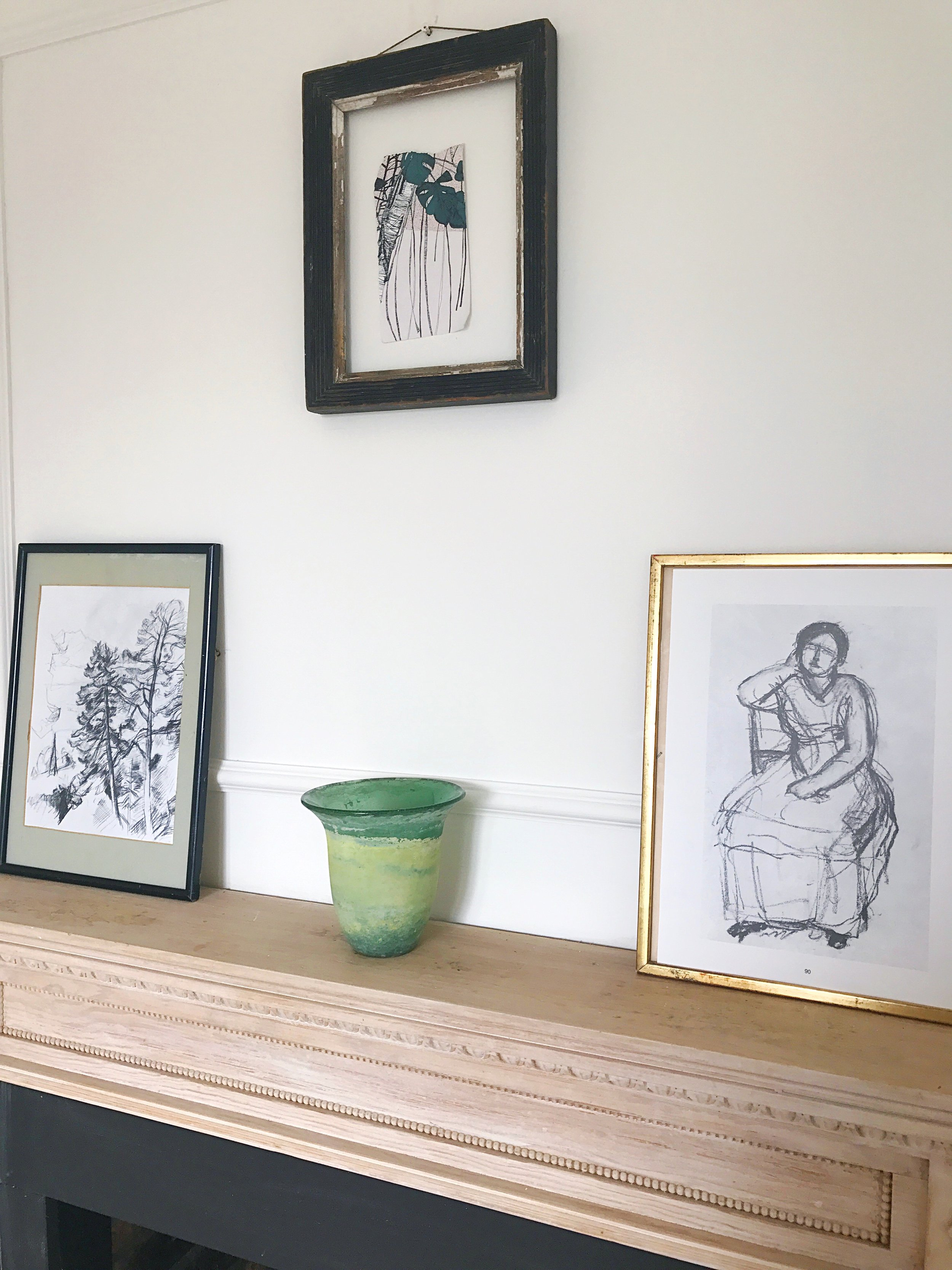A simple gallery wall for styling your mantelpiece.