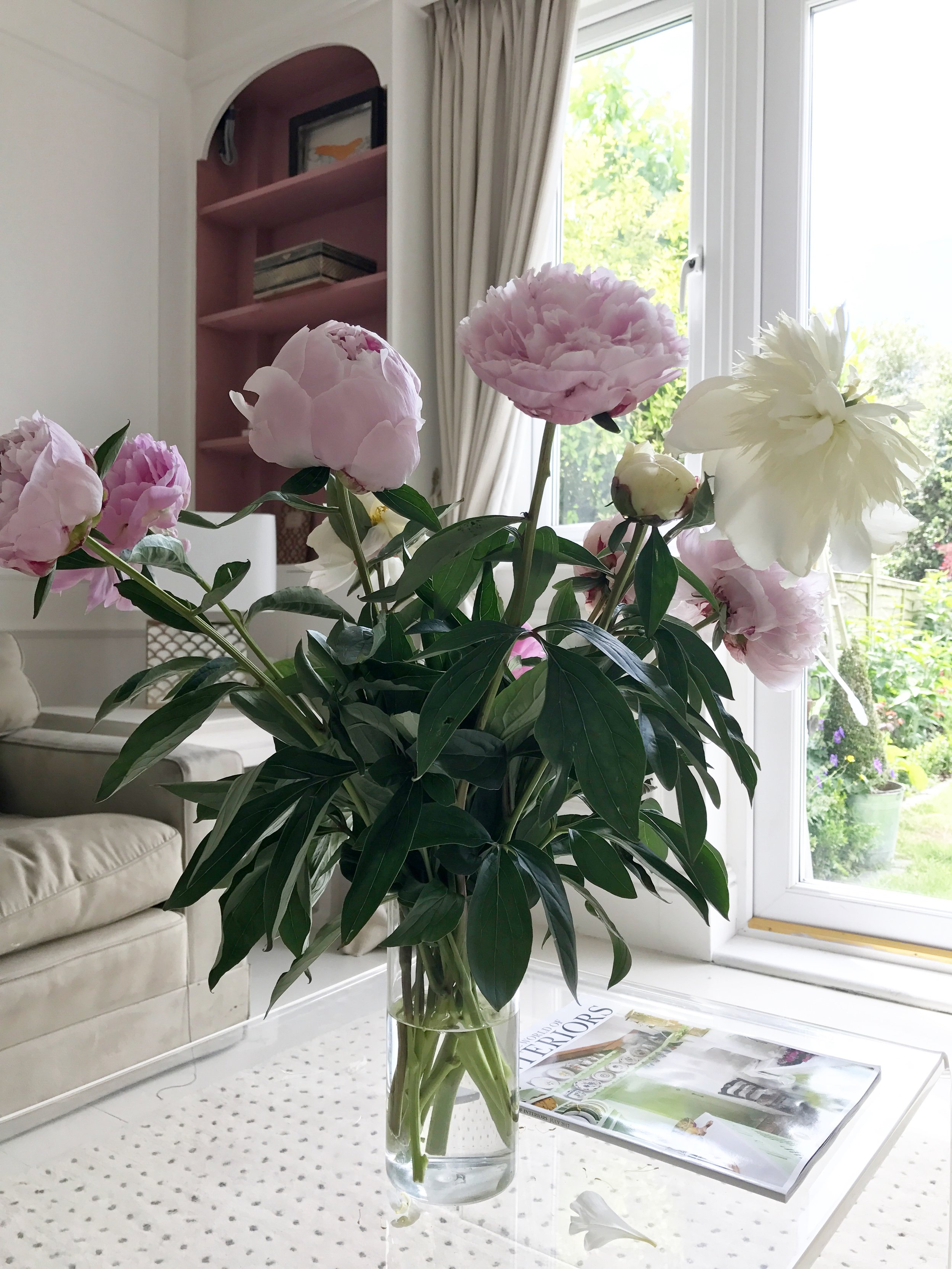 Camilla Pearl arranging flowers at home with Freddies Flowers.