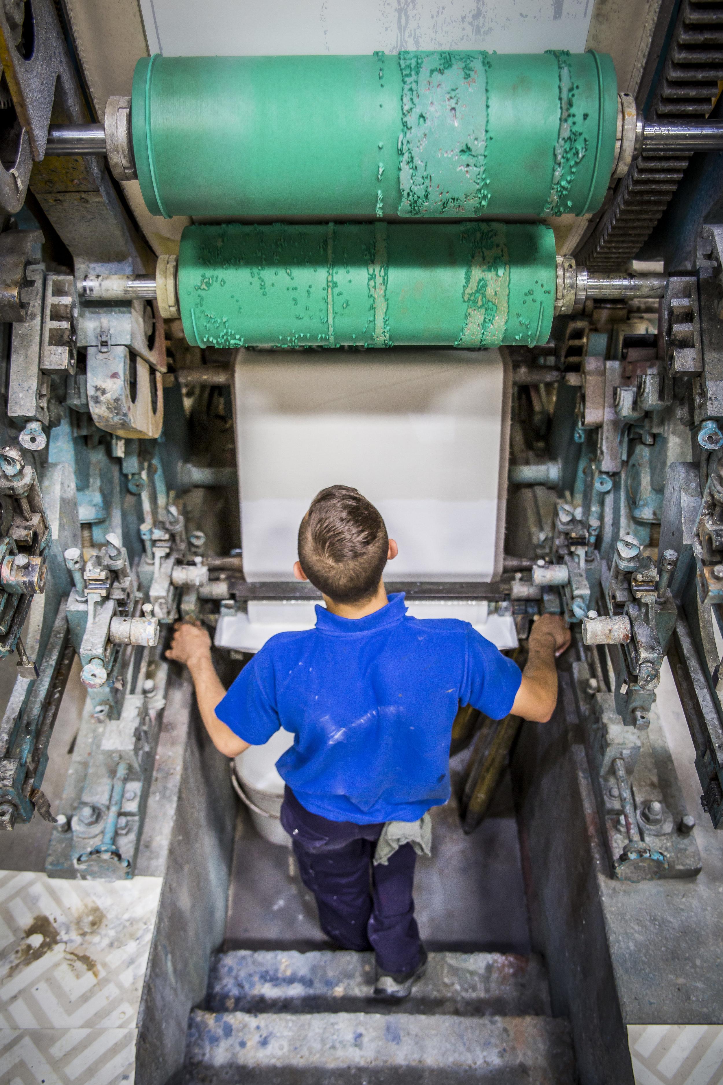 Employee working on Surface Print Machine.JPG