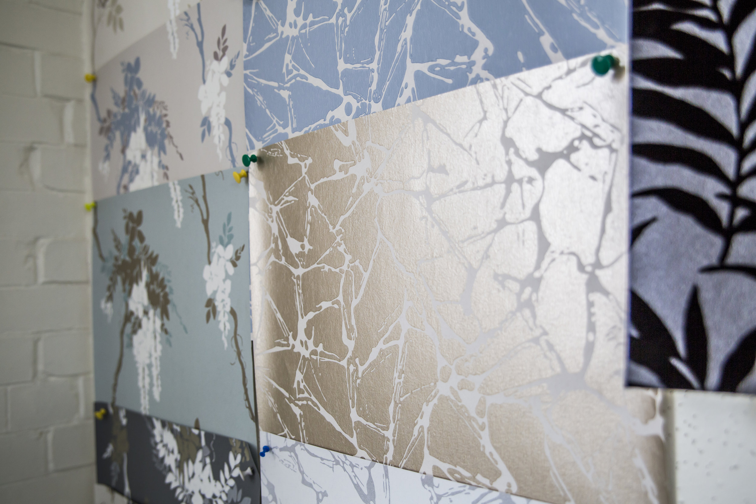Wallcovering Swatches on Wall.JPG