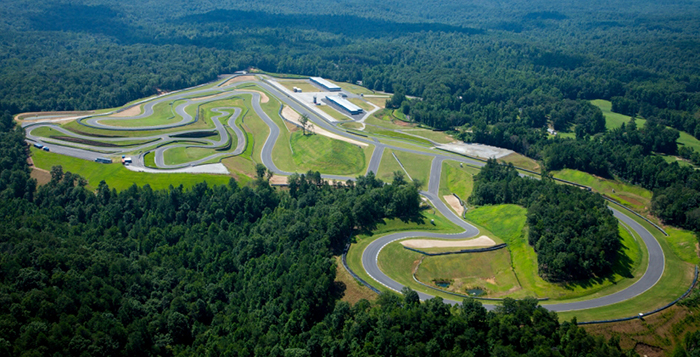 A Driver's Haven Serving Motorsports Enthusiasts   Atlanta Motorsports Park is the first green, sustainable motorsports club of its kind, for high performance cars, motorcycles and karts. In addition to providing a driver's haven for its members, Atlanta Motorsports Park offers private track rentals, corporate group options as well as the world's most unique kart track.  AMP's main road circuit is a two mile long road course that was designed by Formula One track architect Hermann Tilke. The track consists of 16 turns and 98 feet of elevation changes throughout the course. Two famous corners have also been incorporated into the track: Spa-Francorchamp's corner of Eau Rouge and the famous Carousel corner from Germany's Nürburgring track.  In addition to its incredible road course, Atlanta Motorsports Park offers luxury amenities for its members.