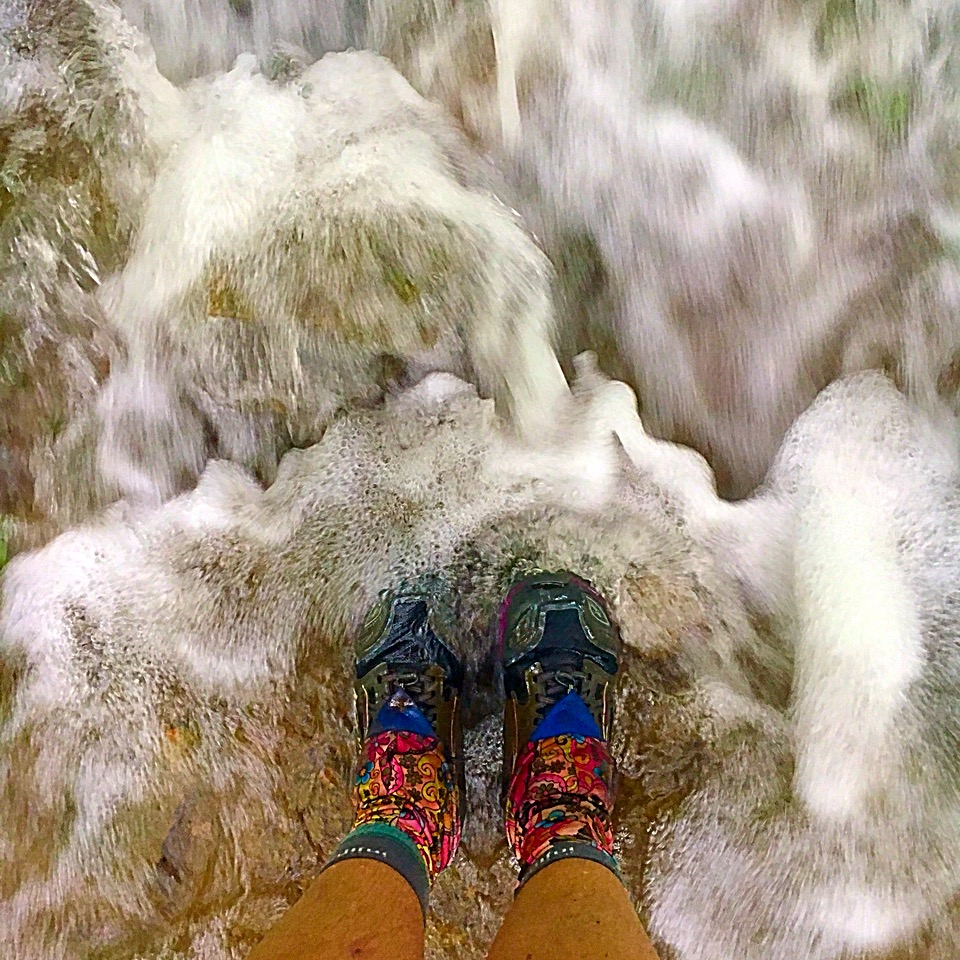 One way to deal with wet feet. Just go ahead and splash in the puddles and streams like a three year old.