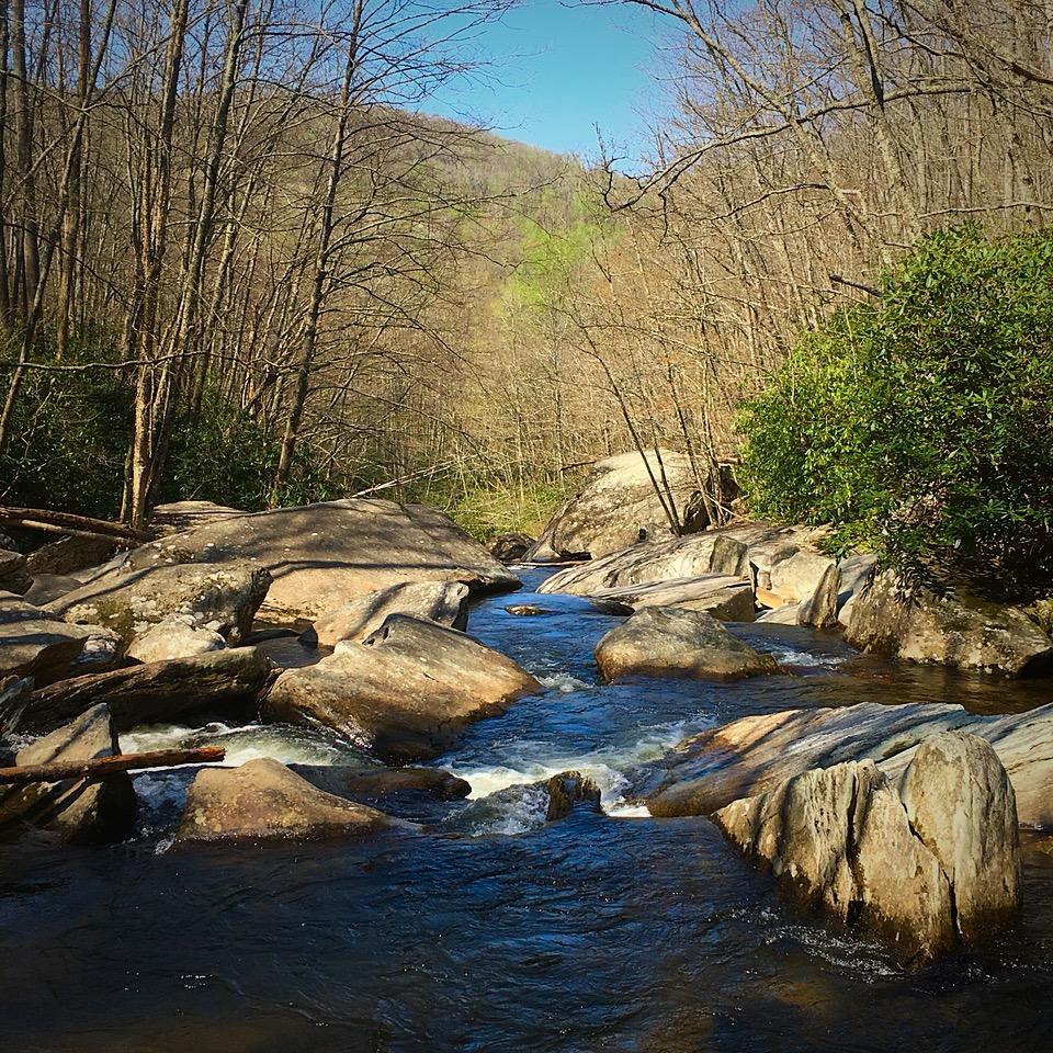 Boone Fork Creek picking its way through boulders, heading toward a long series of waterfalls.
