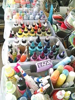 Paints are organized by type such as all High Flow Acrylics together and by warm and cool color family together. This makes it easy to find what I'm looking for without a lot of digging.