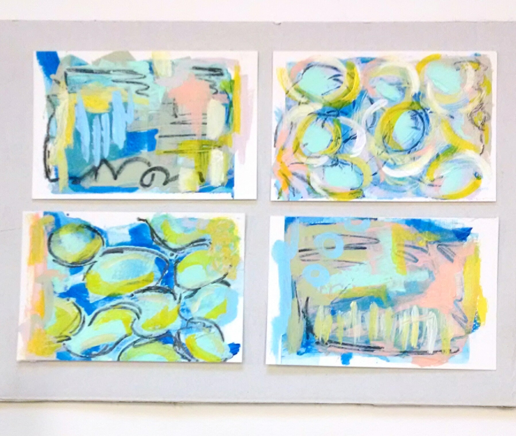"I gave the new light value Heavy Body GOLDEN colors a test drive on top of a Primary Cyan background in these 4x6"" mini paint sketches."